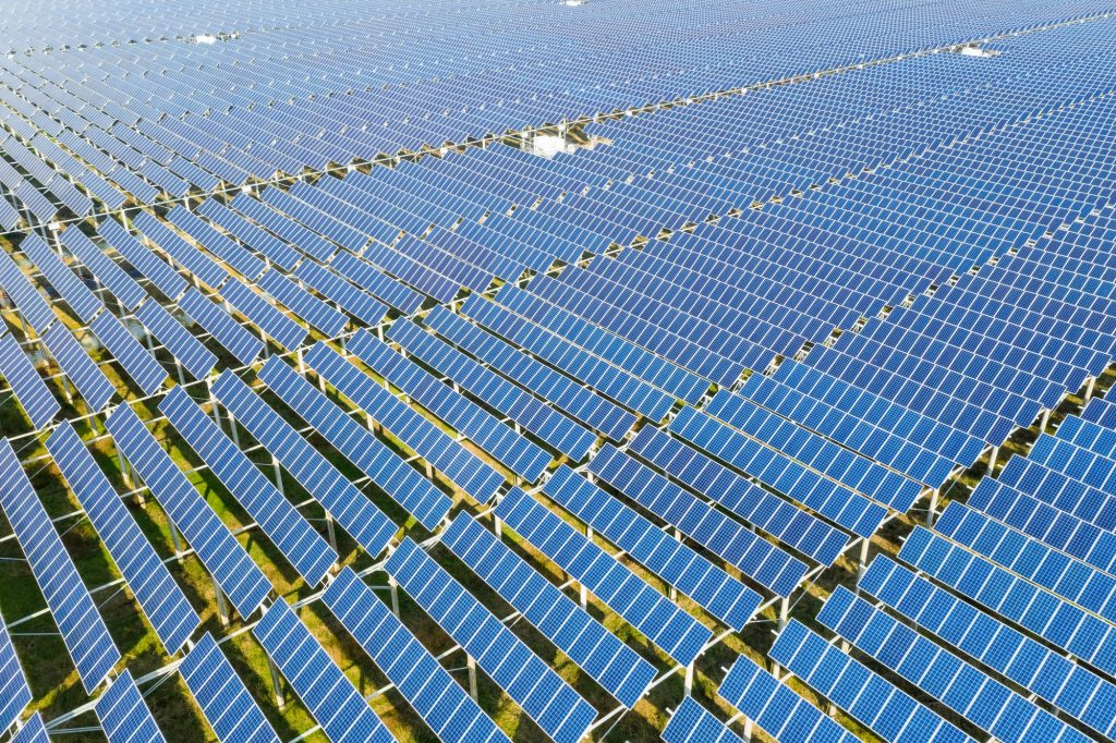 aerial view of solar panels on photovoltaic power station, clean energy background