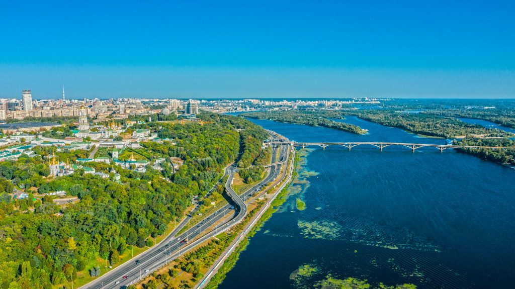 Aerial view to the Beautiful cityscape city Kiev with a Dnepr river in sunny day.