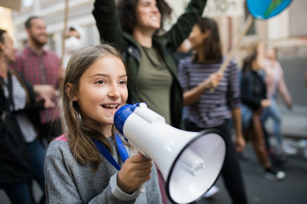 Small child with amplifier on global strike for climate change